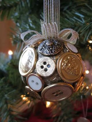 1 handmade ornament, style #3, mix of new & old metal buttons.