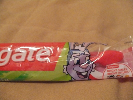 New sealed child toothbrush by Colgate