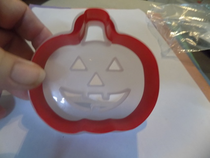 4 inch red plastic Jack-a-lantern cookie cutter with frosted stencil guide