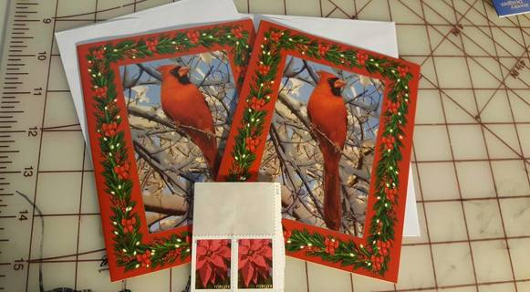 2 red cardinal Xmas cards with 2 stamps