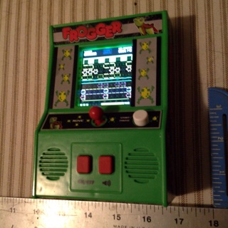Frogger hand held video game, tons of fun !
