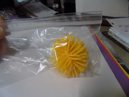 Spikey yellow rubber ball cat toy