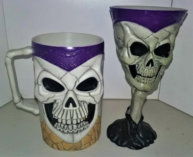 "2 hard plastic Halloween skeleton goblets - 5 1/2"" & 7 1/4"" high"