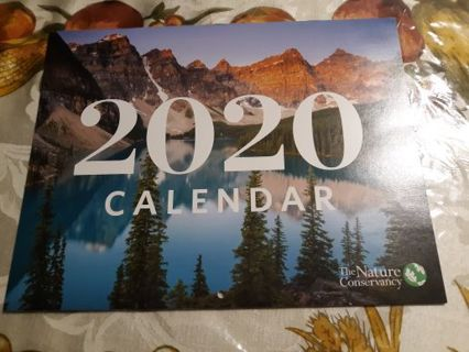 2020 The Nature Conservancy Calendar and Two Sheets Of Silver Wrapping Paper With Dog Paws