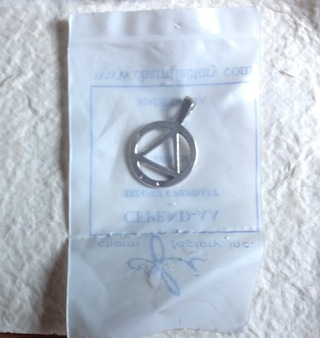 Marked Sterling Silver Triangle AA charm. NIP