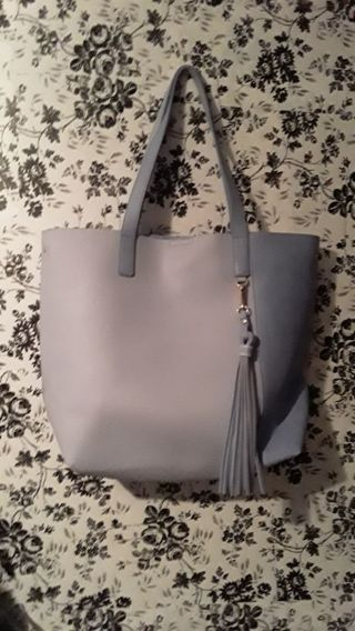 Let's fill a baby blue tote bag with clothing!