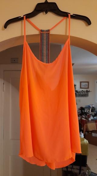 """Ladies orange top by """"Rue 21"""".  Size XL."""
