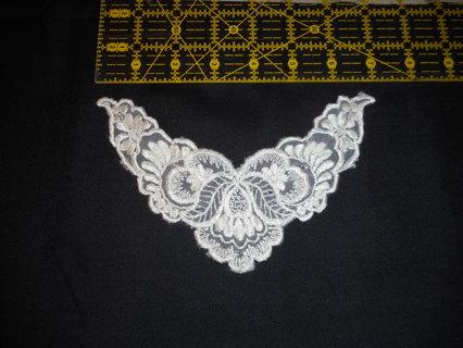 Delicate white lace neckline insert.