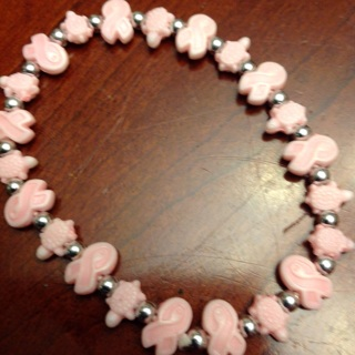 One Pink Cancer Bracelet including Bones Bracelet.