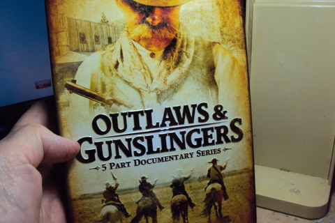 """""""Outlaws & Gunslingers"""" DVD in Metal Container."""