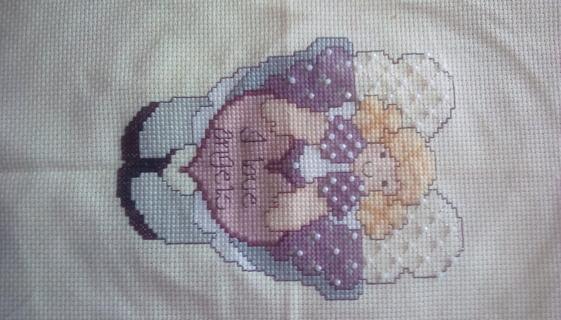 Hand cross stitched angel