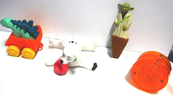 4 Random Collectible Toys..2007 Dalmatians, 2016 Jim Henson, 1999 Light up Yo-yo, Star Wars Pen ,