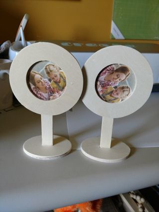 Two Small Round Wood Frames on Stand