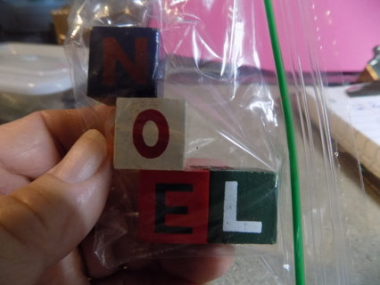 Wooden blocks spell out NOEL stacked