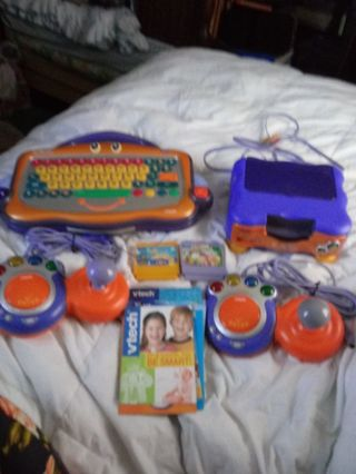 New Condition Vtech. PC Pal Game System & Games