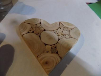 Wooden heart shape trivet looks like sticks & slices of wood