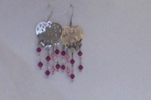 Silver tone earrings with dangling beads