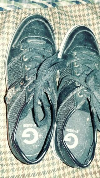 one pair of lady's black shoes, made by guess