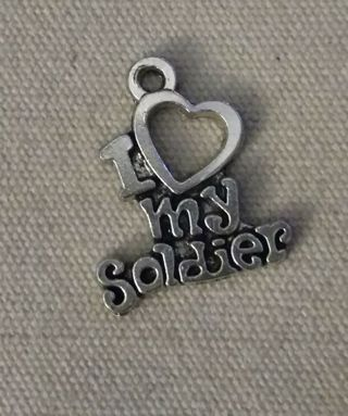 I love my soldier silvertone heart charm . Use get it now and get a free surprise.