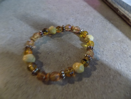 Bracelet light brown fraceted beads accented with white marble beads