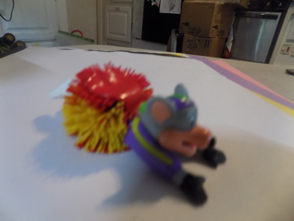 4 inch Chuck E Cheese superhero pvc on red & yellow spikey ball