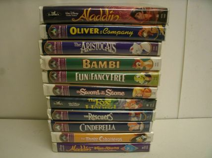 11 Disney VHS Movies with their original clamshell cases Bambi Aladdin