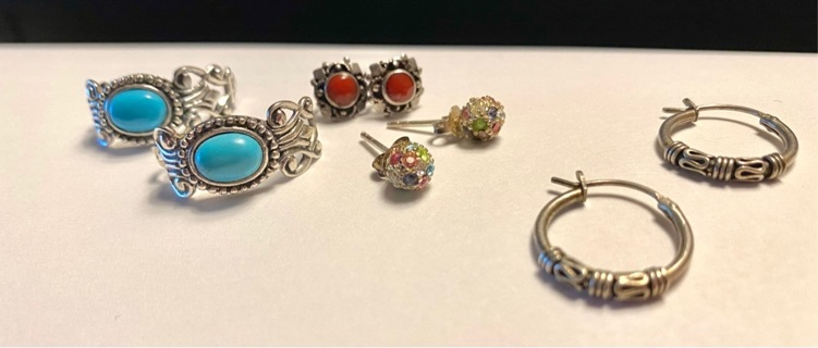 4 pr of pre owned sterling silver earrings (tested)