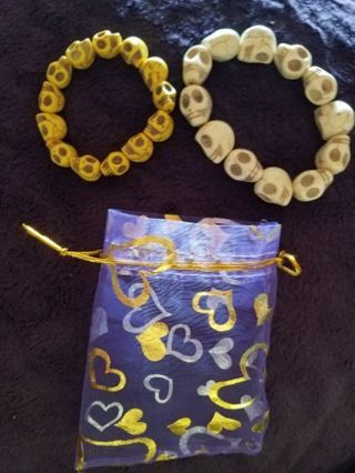 BRAND NEW SET OF TWO DAY OF THE DEAD BRACELETS WITH PURPLE DRAWSTRING BAG