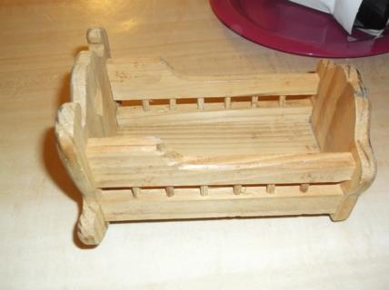 small wooden bassinett