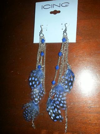 long silver dangle earrings with feathers