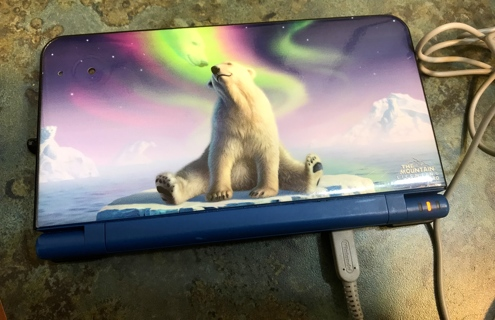 Nintendo DSI XL With Polar Bear Cover, Stylus Pen, Charger and 8 Games