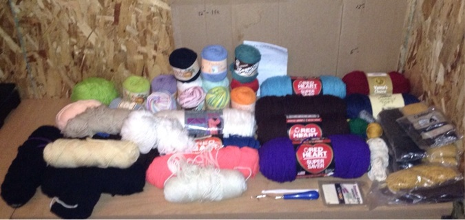32 rolls yarn and 11 packages of latch hook yarn