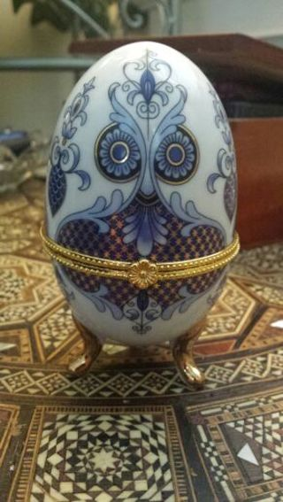 Intricate porcelain egg trinket box