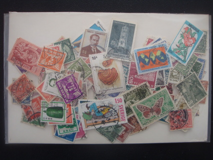 WORLDWIDE used stamps - 100+ all different