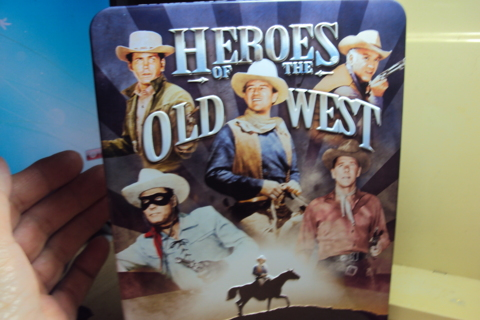 """""""Heroes of the Old West"""" 4 Disc with metal container."""