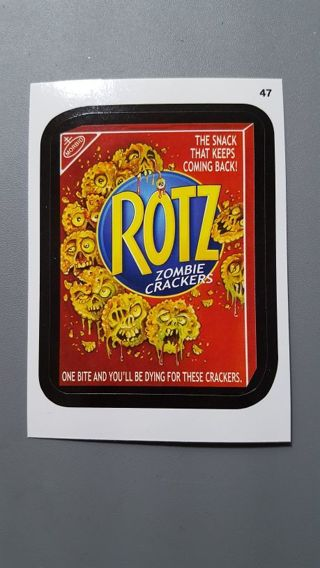 2015 Topps Wacky Packages • Card #47 • ROTZ ZOMBIE CRACKERS • See Photos