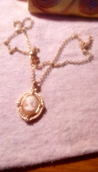 Gold tone cameo necklace