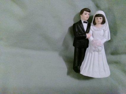 Ceramic bride & groom figurine