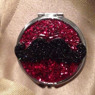 Decorative mirror compact mustache