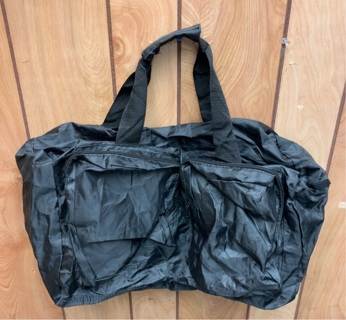Black lightweight duffle bag or weekend bag
