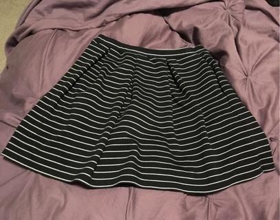 Black mini skirt with white stripes