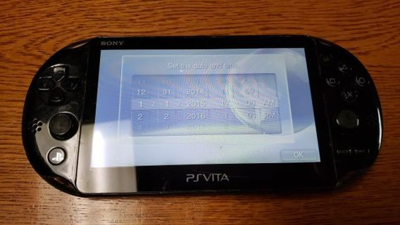 PSVita Handheld Game System with 4 Games