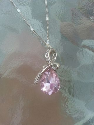 Silver brand new necklace with pink tear drop pendant very pretty!