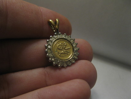 nice Gold Pendant with Small Panda Coin in it.