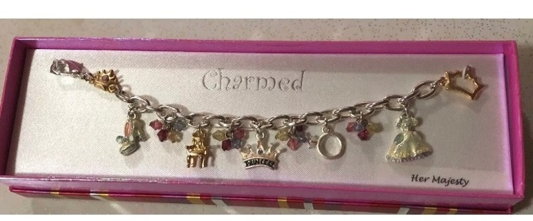 NWT Charmed Her Majesty Charm Bracelet In Original Box. Condition is New with tags