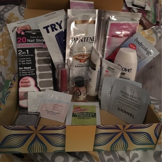 Small box full of beauty samples and makeup