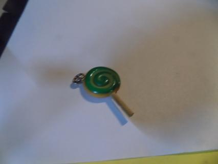 Reversable color red & green swirl lollipop pendant charm