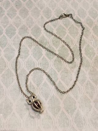 Genuine maroon pearl in silver Tone owl cage on 20 inch silver Tone chain