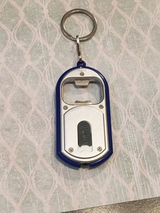 Bottle opener flash light key chain Great stocking stuffer