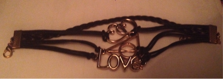 Bracelet with faux leather and charms